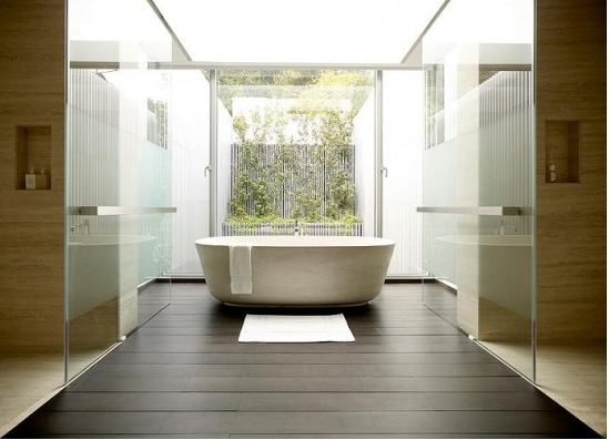 modern bath with wood walls and white ceiling