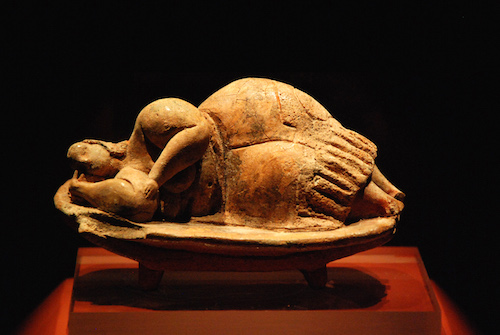 "This clay figure was found in a pits of the Hypogeum in Hal Saflieni in Malta. It is thought to represent a ""mother goddess"". Temple Period, 4000 - 2500 BC."